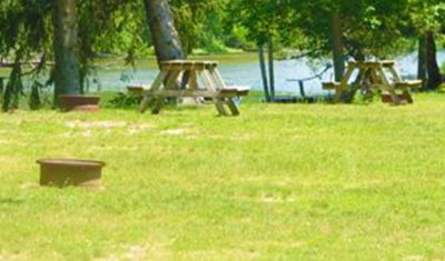 Campsites are equipped with a picnic table and fire pit